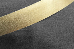 Golden ribbon on black Stock Images