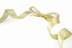 Golden ribbon and bow. Isolated on white background with excellent space for copy Royalty Free Stock Photography