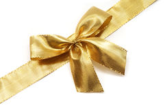 Golden ribbon with a bow Stock Image