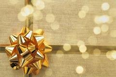 Golden ribbon bow with bokeh Stock Photos