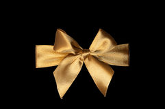 Golden ribbon bow isolate. On black Royalty Free Stock Photo