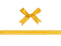 Golden ribbon and bow isolated Stock Images