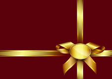 Golden ribbon bow and label on red invitation card Stock Photography