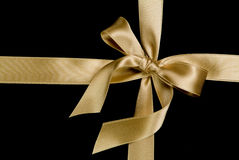 Golden ribbon and bow Royalty Free Stock Photos