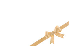 Golden ribbon with a bow Royalty Free Stock Photo