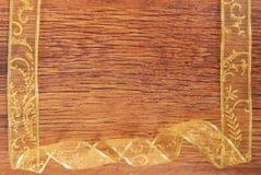 Golden ribbon frame  on wood Stock Photo