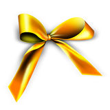 Golden ribbon for a gift. A golden ribbon with a knot isolated on white Royalty Free Stock Images