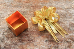 Golden Ribbon and Golden Gift Box Stock Photography