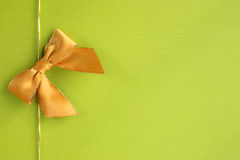Golden ribbon on green background royalty free stock images