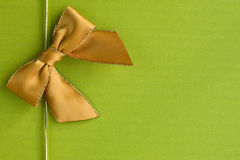 Golden ribbon on green background Royalty Free Stock Photos