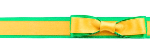 Golden and green ribbon border. Golden ribbon and green border isolated on white background royalty free stock photos
