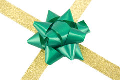 Golden ribbon with green bow. Christmas decoration golden ribbon with green bow isolated on white Stock Photography