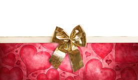 Golden ribbon on a heart background Royalty Free Stock Images