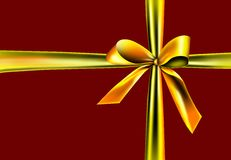 Golden ribbon on a red background Stock Image