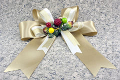 Golden ribbon on striped paper Royalty Free Stock Photography