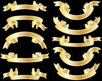 Golden ribbons. Set of golden striped ribbons on black background Royalty Free Stock Image