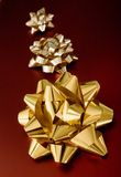 Golden ribbons on red gifts Royalty Free Stock Photography
