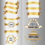 Golden ribbons set and sale labels. Stock Photography