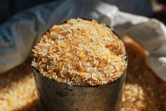 Golden rice in cup. Golden rice containing in stainless cup Royalty Free Stock Photography