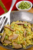 Golden rice in pan with mushrooms Stock Images