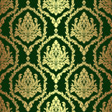 Golden rich floral damask Wallpaper on green. Stock Images