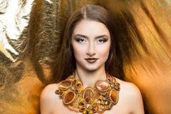Golden rich woman Stock Photo
