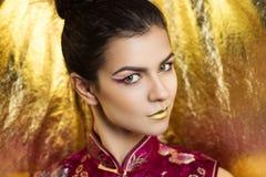 Golden rich woman Stock Images