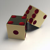Golden right handed casino dice Royalty Free Stock Photography