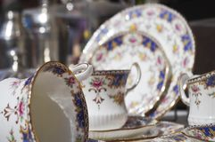 Tea party porcelain ceramic set. Closeup of crafted fired glazed porcelain set golden rimmed and vibrantly colored. housewares dishes occassions weddings stock image
