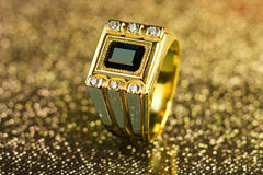 Gold ring with diamonds and sapphire Royalty Free Stock Image