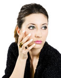 Golden ring. Portrait of young beautiful woman with manicured fingers and golden ring Royalty Free Stock Photos