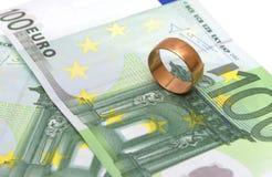 Golden Ring. Golden wedding ring money on a white background Stock Image