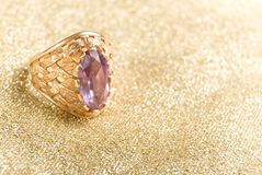 The Golden Ring with amethyst Royalty Free Stock Photos