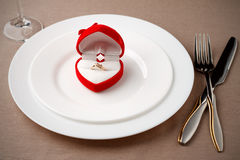 Golden ring in beautiful box on white plate. Stock Image