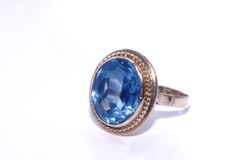 Golden ring with blue aquamarine Royalty Free Stock Photo