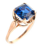 Golden ring with blue gem Stock Photo