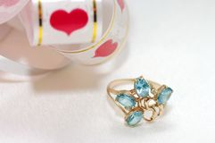 Golden ring with blue topaz Stock Image
