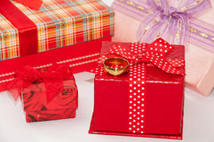 Golden ring and bunch of gift box with bows Royalty Free Stock Image
