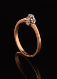 Golden ring with diamond on black background Royalty Free Stock Photos