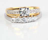 Golden ring with diamond and contemporary diamond ring. Golden ring with diamond and contemporary diamond ring, isolated on white background Stock Images