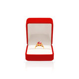 Golden ring with diamond in red box isolated on white background. Golden ring with diamond in red box isolated on a white background Royalty Free Stock Photos