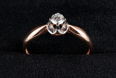 Golden ring with diamond shot on velvet Royalty Free Stock Photo