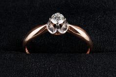 Golden ring with diamond shot on velvet Royalty Free Stock Photo