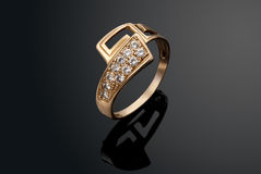 Golden ring with diamonds Stock Photos