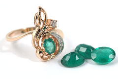 Golden ring with emerald Stock Images