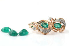 Golden ring with emerald Royalty Free Stock Image