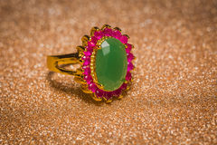 Golden Ring with Emerald Stock Photos