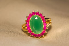 Golden Ring with Emerald Stock Photo