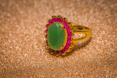 Golden Ring with Emerald Stock Photography