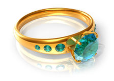 Golden ring with emeralds Stock Photo